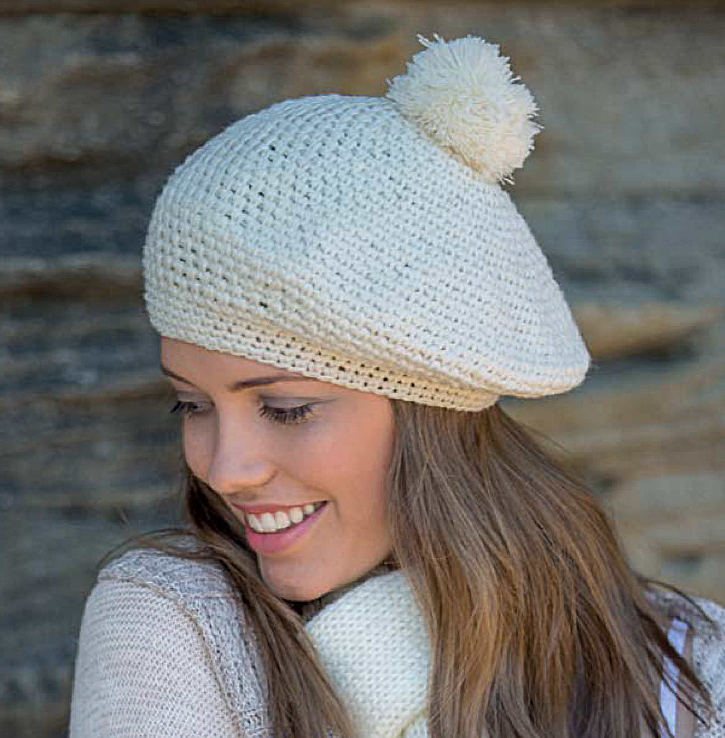 RL292 parisian crocheted beret. Loose crochet design with decorative pom pom. A fun and quirky addition to our winter range.